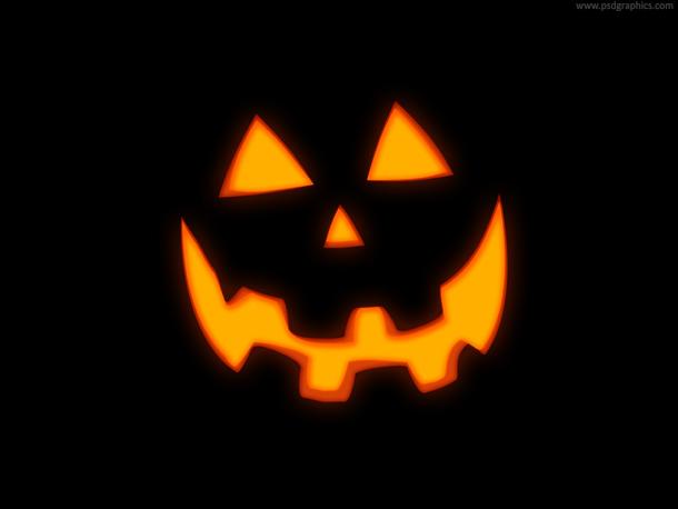 Glowing Jack O' Lantern pumpkin in the night
