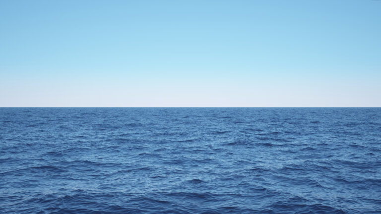 Extra wide blue open sea background with a clear blue sky