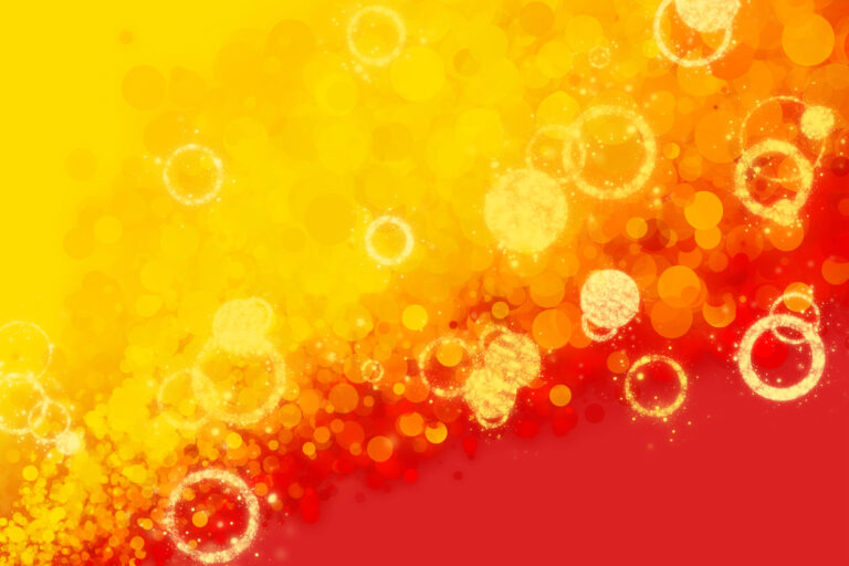 Red and yellow gradient background with decorative bubbles and rings