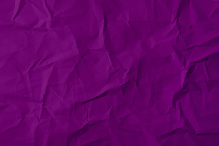 A dark purple paper texture, crumpled surface finish